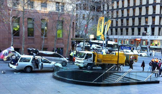 Police and city council workers move in to dismantle the Occupy Sydney camp. Photo: 7News