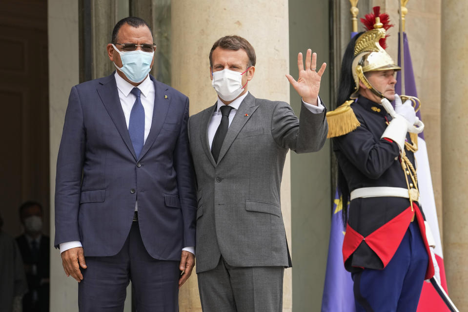 Niger's President Mohamed Bazoum, left, is welcomed by France's President Emmanuel Macron for a video-summit with leaders of the G5 Sahel at the Elysee Palace, Friday, July 9, 2021. (AP Photo/Michel Euler)