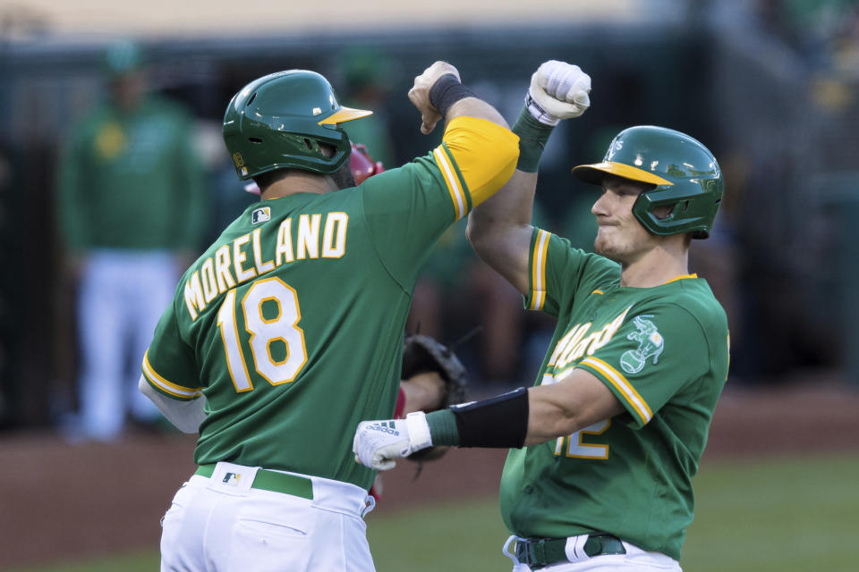 Oakland Athletics' Sean Murphy, right, celebrates with teammate Mitch Moreland (18) after hitting a solo home run against the Los Angeles Angels during the second inning of a baseball game in Oakland, Calif., Monday, June 14, 2021. (AP Photo/John Hefti)
