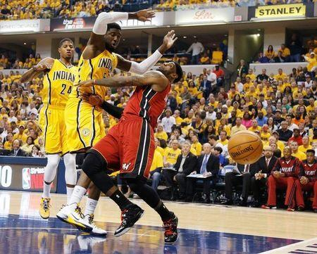 May 18, 2014; Indianapolis, IN, USA; Miami Heat forward LeBron James (6) loses the ball after running into Indiana Pacers center Roy Hibbert (55) in game one of the Eastern Conference Finals of the 2014 NBA Playoffs at Bankers Life Fieldhouse. Brian Spurlock-USA TODAY Sports