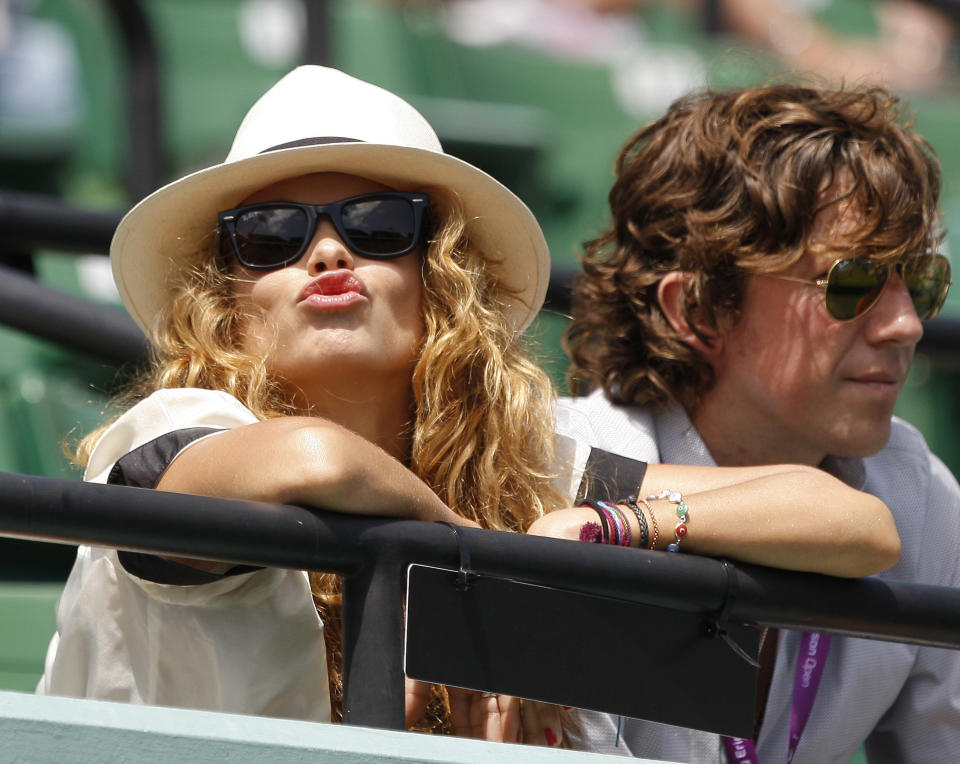 Mexican singer and actress Paulina Rubio (L) blows a kiss as she watches a semifinal match between Rafael Nadal of Spain and Tomas Berdych of Czech Republic at the Sony Ericsson Open tennis tournament in Key Biscayne, Florida April 4, 2008.  REUTERS/Carlos Barria  (UNITED STATES)