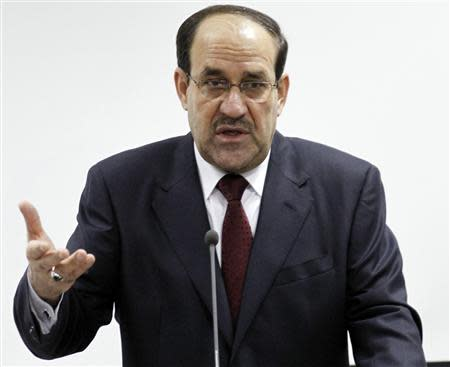 Iraq's Prime Minister Nuri al-Maliki speaks during the opening ceremony of the Defence University for Military Studies in Baghdad in this file photo taken June 17, 2012. REUTERS/Thaier al-Sudani/Files