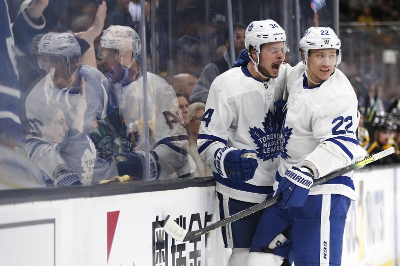 Toronto Maple Leafs' Auston Matthews (34) celebrates his goal with Nikita Zaitsev during the third period in Game 5 of an NHL hockey first-round playoff series against the Boston Bruins in Boston, Friday, April 19, 2019. (AP Photo/Michael Dwyer)