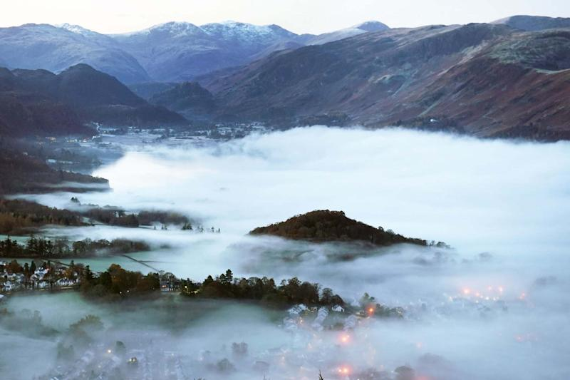 Mist over the town of Keswick in the Lake District: PA