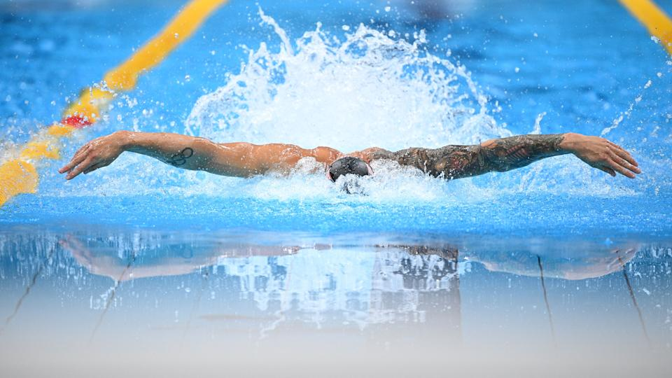 <p>USA's Caeleb Dressel competes in the final of the men's 100m butterfly swimming event during the Tokyo 2020 Olympic Games at the Tokyo Aquatics Centre in Tokyo on July 31, 2021. (Photo by Oli SCARFF / AFP)</p>