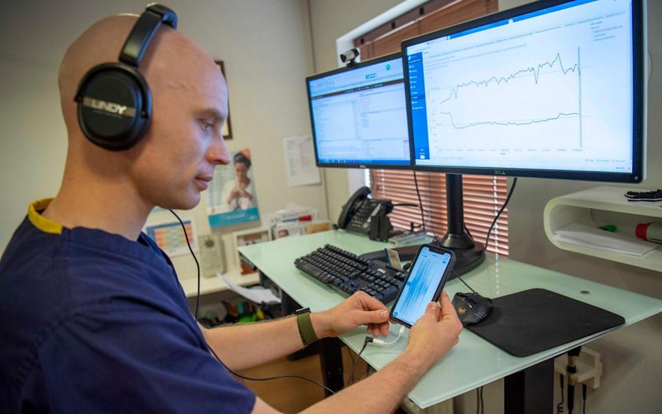 GP Dave Trisk viewing the app on his phone showing the readings from the new stethoscope which can be used between separate rooms. - Paul Grover