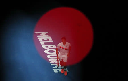 Tennis - Australian Open - Rod Laver Arena, Melbourne, Australia, January 20, 2018. Roger Federer of Switzerland is pictured through the red LED light of tv camera equipment during his match against Richard Gasquet of France. REUTERS/Edgar Su