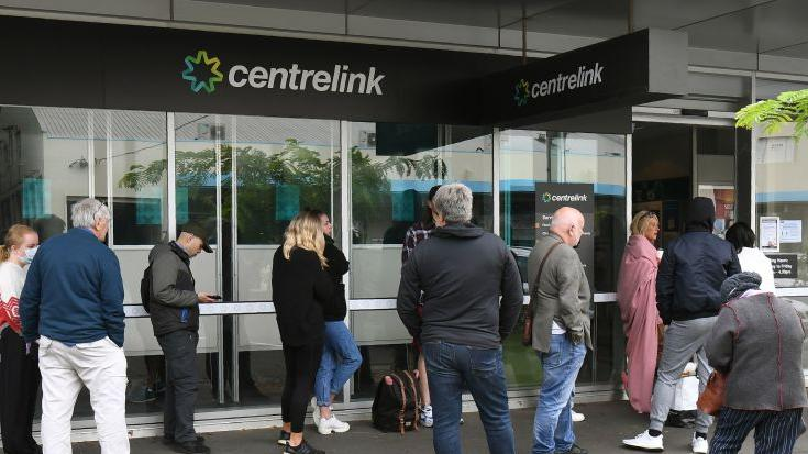 Hundreds of people queue outside an Australian government welfare centre, Centrelink, in Melbourne on March 23, 2020, as jobless Australians flooded unemployment offices around the country after Prime Minister Scott Morrison warned the coronavirus pandemic would cause an economic crisis akin to the Great Depression. (Photo by WILLIAM WEST/AFP via Getty Images)