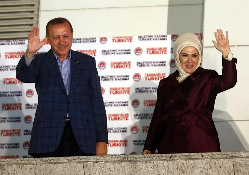 Newly elected Turkish president Recep Tayyip Erdogan and his wife Ermine wave at supporters from the balcony of the AKP party headquarters during the celebrations of his victory in the presidential election vote in Ankara on August 10, 2014