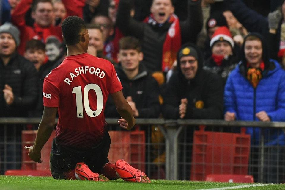 Crowd pleaser: Marcus Rashford has scored in four straight Premier League games for Manchester United (AFP Photo/Oli SCARFF )