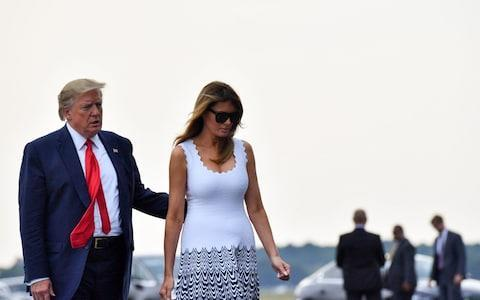 Photo of US President Donald Trump with his wife Melania, talking towards Air Force One in Bordeaux - Credit: Nicholas Kamm/AFP