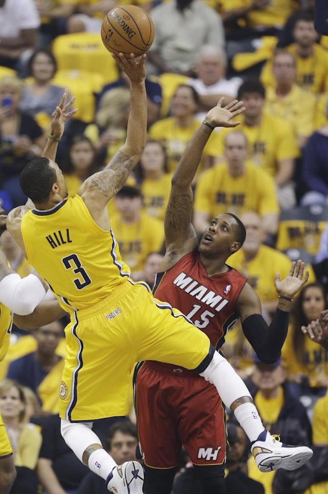 Indiana Pacers guard George Hill (3) shoots over Miami Heat guard Mario Chalmers (15) during the first half of Game 1 of the Eastern Conference finals NBA basketball playoff series Sunday, May 18, 2014, in Indianapolis. (AP Photo/Darron Cummings)