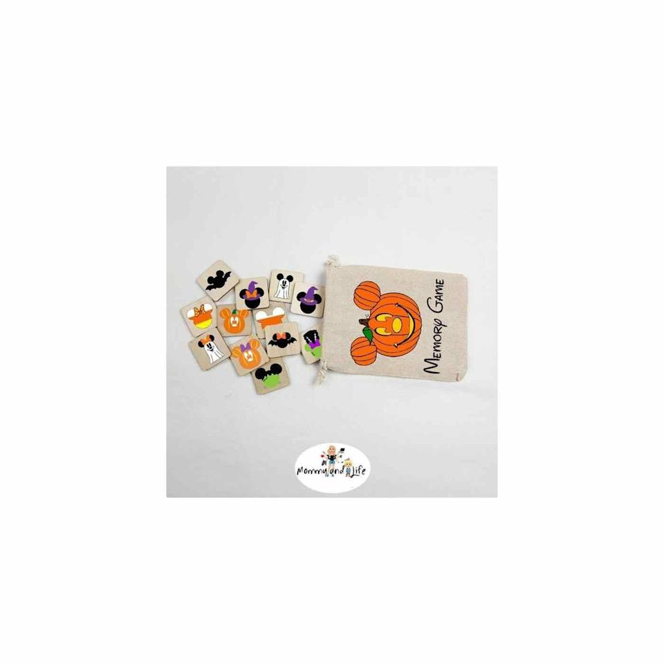 """<p><strong>Mommyandlife</strong></p><p>etsy.com</p><p><strong>$30.00</strong></p><p><a href=""""https://go.redirectingat.com?id=74968X1596630&url=https%3A%2F%2Fwww.etsy.com%2Flisting%2F875891065%2Fwooden-halloween-memory-game&sref=https%3A%2F%2Fwww.oprahdaily.com%2Flife%2Fg33543751%2Fhalloween-party-games%2F"""" rel=""""nofollow noopener"""" target=""""_blank"""" data-ylk=""""slk:Shop Now"""" class=""""link rapid-noclick-resp"""">Shop Now</a></p><p>Looking for a game everyone from the grandparents to the grandkids can enjoy together? Try this Disney-inspired Halloween matching game. </p>"""