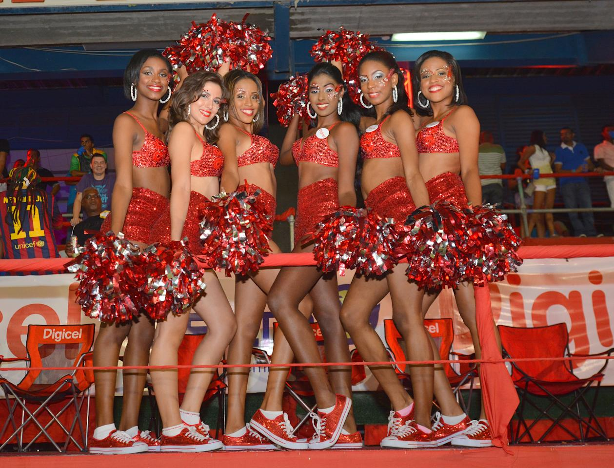 PORT OF SPAIN, TRINIDAD AND TOBAGO - AUGUST 24: Cheerleaders cheer their team during the Final of the Cricket Caribbean Premier League between Guyana Amazon Warriors v Jamaica Tallawahs at Queen's Park Oval on August 24, 2013 in Port of Spain, Trinidad and Tobago. (Photo by Lloyd Pierre/Getty Images Latin America for CPL)