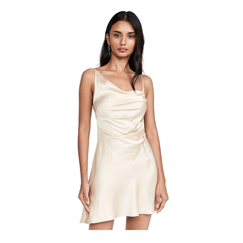 """The asymmetric straps *would* steal the show for this champagne-colored dress, but the subtle high-low hem and artful draping are not to be missed. $259, Amazon. <a href=""""https://www.amazon.com/Fame-Partners-Womens-Selene-Dress/dp/B09BX5YXPV"""" rel=""""nofollow noopener"""" target=""""_blank"""" data-ylk=""""slk:Get it now!"""" class=""""link rapid-noclick-resp"""">Get it now!</a>"""