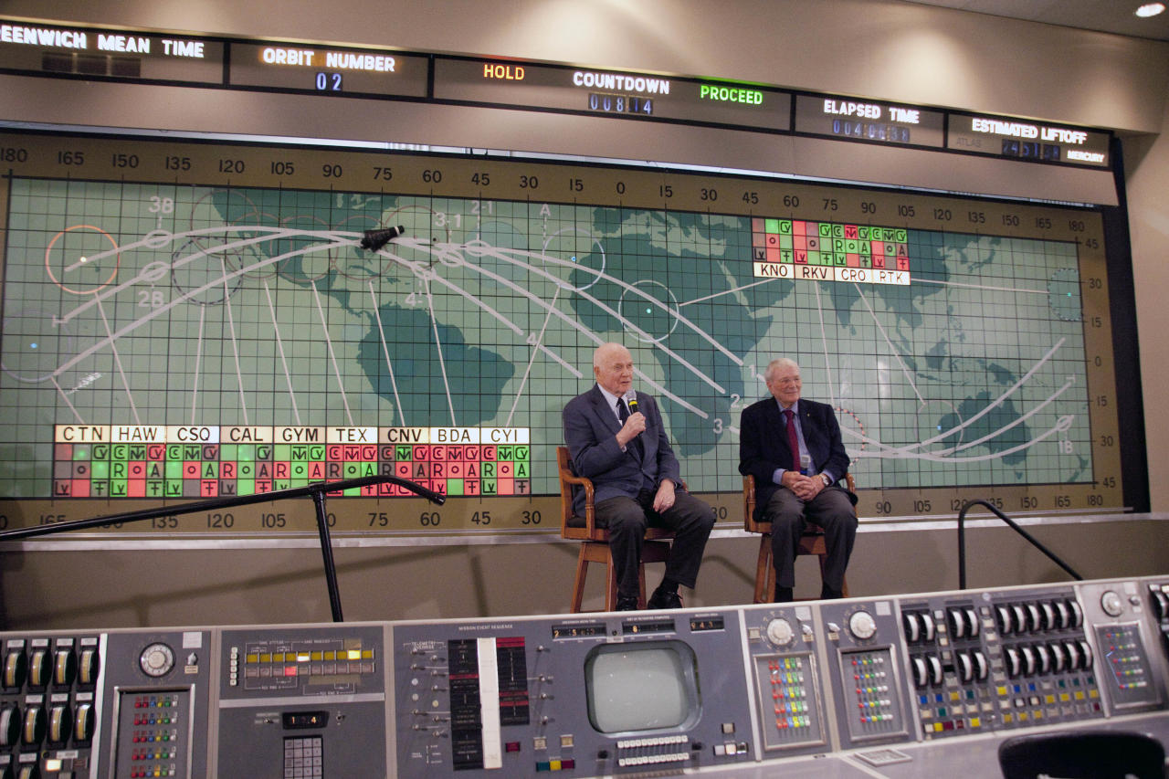 Former Sen. John Glenn, left, and Scott Carpenter, right, speak at the Kennedy Space Center, Friday, Feb. 17, 2012 in Cape Canaveral, Fla. John Glenn fever has taken hold in the U.S. once again. Three days before the 50th anniversary of his historic flight, the first American to orbit the Earth addressed employees at Kennedy Space Center. (AP Photo/Michael Brown)
