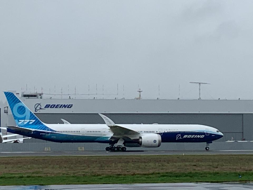 Boeing 777X taxis on runway