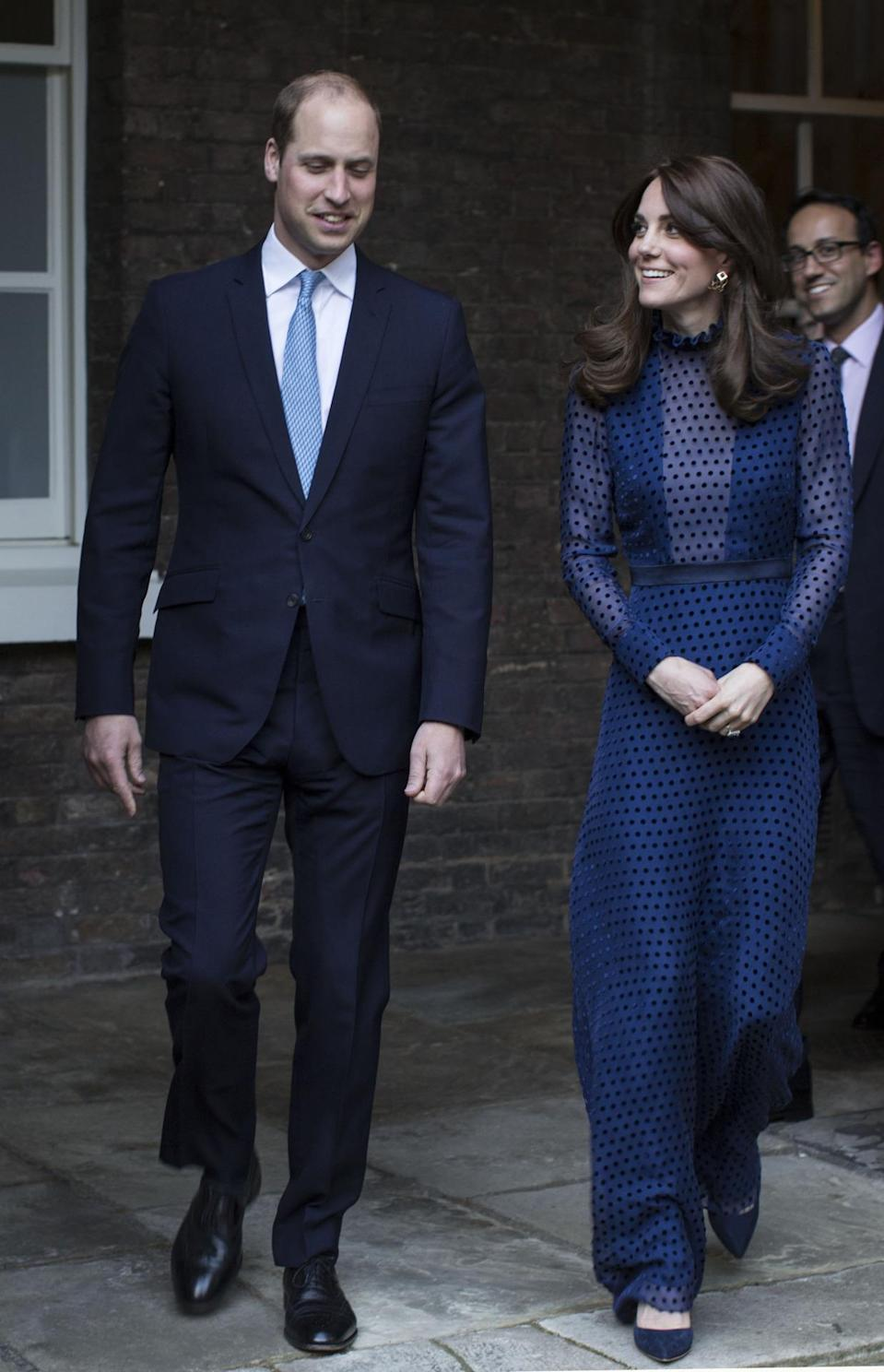 <p>Opting for a navy polka dot gown by Saloni, Kate attended a reception at Kensington Palace. Simple Rupert Sanderson heels finished the look. </p><p><i>[Photo: PA]</i></p>