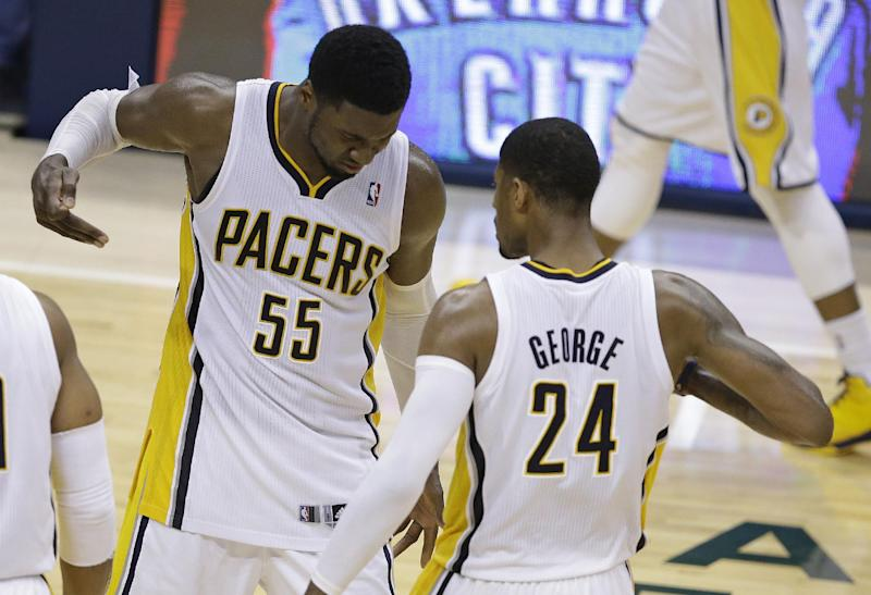 Indiana Pacers' Roy Hibbert and Paul George celebrate after George hit a shot as time expired to end the third quarter of Game 5 of the Eastern Conference finals NBA basketball playoff series against the Miami Heat on Wednesday, May 28, 2014, in Indianapolis