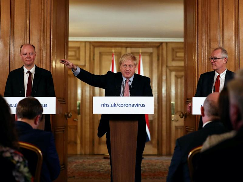 Boris Johnson alongside chief medical officer Chris Whitty (left) and chief scientific adviser Sir Patrick Vallance: PA