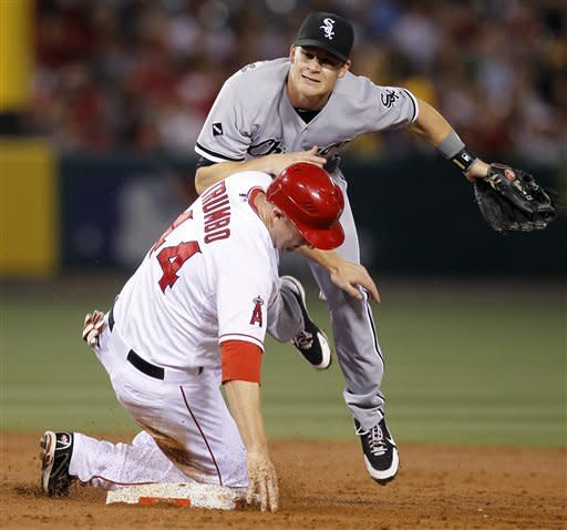 Los Angeles Angels' Mark Trumbo is forced out at second by Chicago White Sox second baseman Gordon Beckham while trying to advance on a ball hit by Howard Kendrick during the third inning of a baseball game in Anaheim, Calif., Wednesday, May 16, 2012. Kendrick was safe at first. (AP Photo/Chris Carlson)