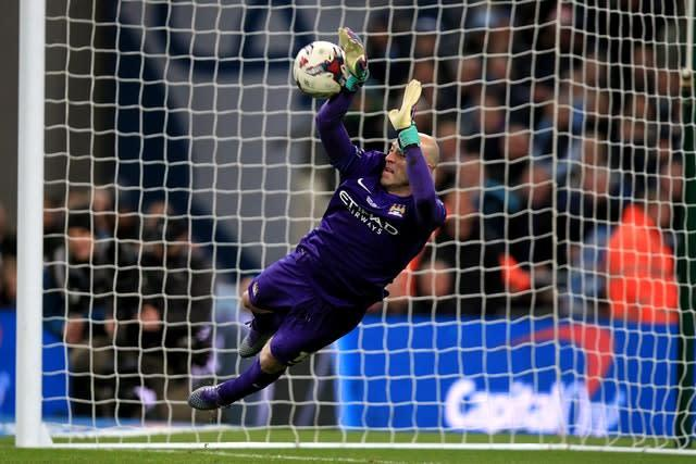 City goalkeeper Willy Caballero saves from Lucas Leiva on his way to becoming a Wembley penalty shoot-out hero in 2016 (Mike Egerton/PA)