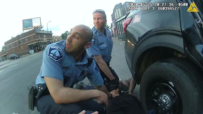 SENSITIVE MATERIAL. THIS IMAGE MAY OFFEND OR DISTURB. George Floyd is kneeled upon by former Minneapolis Police Department (MPD) officer Derek Chauvin next to former MPD officer J. Alexander Kueng, as seen in a still from the body camera video of former MPD officer Thomas Lane, during the police custody in which he died in Minneapolis, Minnesota, U.S. May 25, 2020. Video taken May 25, 2020. MPD/Hennepin County District Court/Handout via REUTERS THIS IMAGE HAS BEEN SUPPLIED BY A THIRD PARTY.