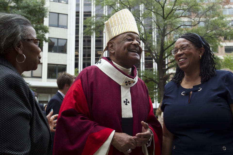 FILE - In this Sunday Oct. 6, 2019, file photo, Washington D.C. Archbishop Wilton Gregory greets churchgoers at St. Mathews Cathedral after the annual Red Mass in Washington. Pope Francis on Sunday, Oct. 25, 2020, named 13 new cardinals, including Washington D.C. Archbishop Wilton Gregory, who would become the first Black U.S. prelate to earn the coveted red hat. In a surprise announcement from his studio window to faithful standing below in St. Peter's Square, Francis said the churchmen would be elevated to a cardinal's rank in a ceremony on Nov. 28. (AP Photo/Jose Luis Magana, File)