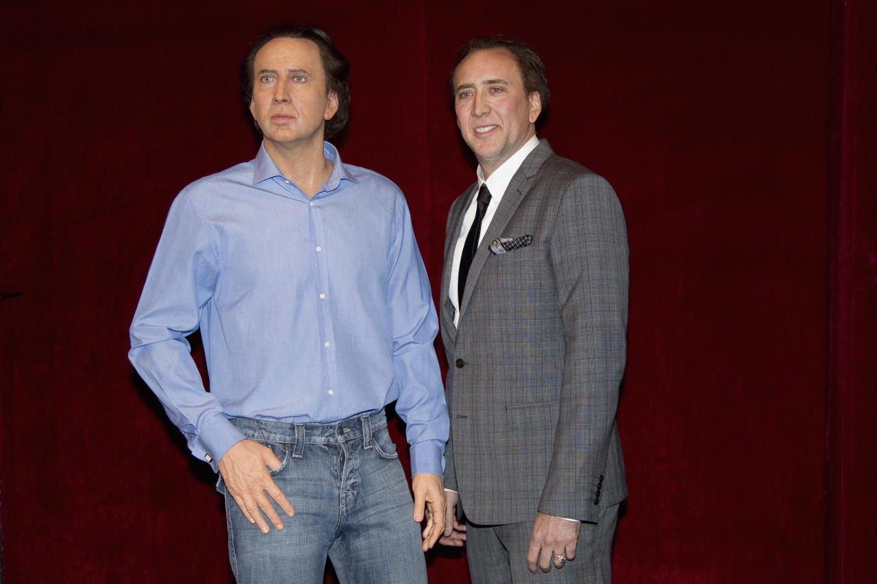 U.S. actor Nicolas Cage (R) stands next to his figure at the Grevin wax museum during the presentation of his waxwork in Paris January 29, 2012.  REUTERS/ Gonzalo Fuentes