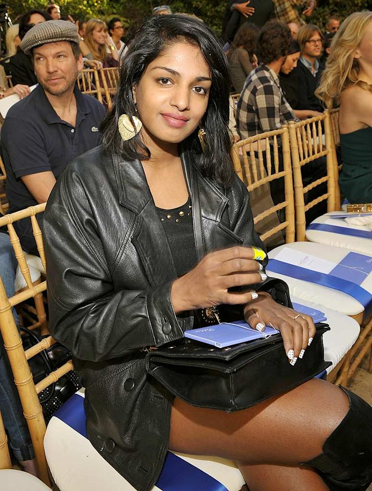 "M.I.A.'s known for having a crazy sense of style, that's why we almost didn't recognize her in this basic black mini, leather jacket, and boots. John Shearer/<a href=""http://www.wireimage.com"" target=""new"">WireImage.com</a> - October 30, 2009"