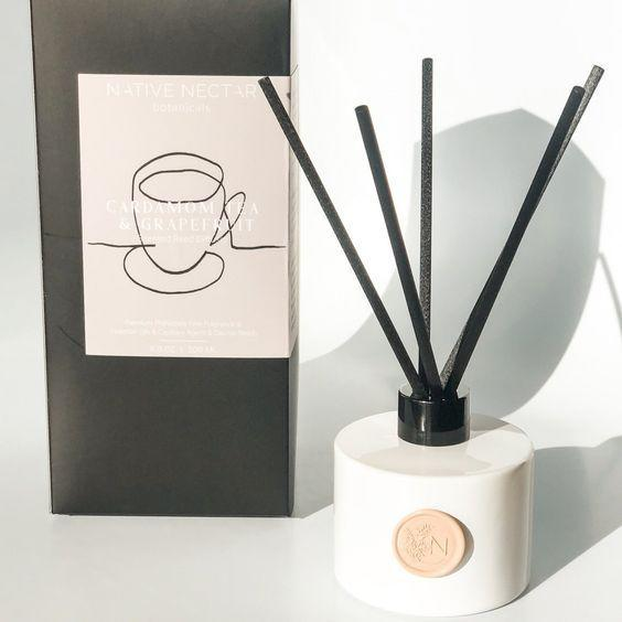 """This striking diffuser's premium oil emits a gorgeous scent filled with notes of ginger, cardamom, pink pepper, cinnamon, amber, and grapefruit. <a href=""""https://www.ritualsandceremony.com/shop-1"""" rel=""""nofollow noopener"""" target=""""_blank"""" data-ylk=""""slk:Rituals & Ceremony"""" class=""""link rapid-noclick-resp"""">Rituals & Ceremony</a> also carries diffusers in equally to-die-for scents including <a href=""""https://www.ritualsandceremony.com/shop-1/amber-lime-sugared-plum-reed-diffuser"""" rel=""""nofollow noopener"""" target=""""_blank"""" data-ylk=""""slk:amber, lime, and sugared plum"""" class=""""link rapid-noclick-resp"""">amber, lime, and sugared plum</a>, or <a href=""""https://www.ritualsandceremony.com/shop-1/white-rose-fir-needle-reed-diffuser"""" rel=""""nofollow noopener"""" target=""""_blank"""" data-ylk=""""slk:white rose and fir needle"""" class=""""link rapid-noclick-resp"""">white rose and fir needle</a>. Can't decide which fragrance to pick? Maybe just splurge and get the new homeowner all three. $38, Rituals & Ceremony. <a href=""""https://www.ritualsandceremony.com/shop-1/cardamom-tea-grapefruit-scented-reed-diffuser"""" rel=""""nofollow noopener"""" target=""""_blank"""" data-ylk=""""slk:Get it now!"""" class=""""link rapid-noclick-resp"""">Get it now!</a>"""