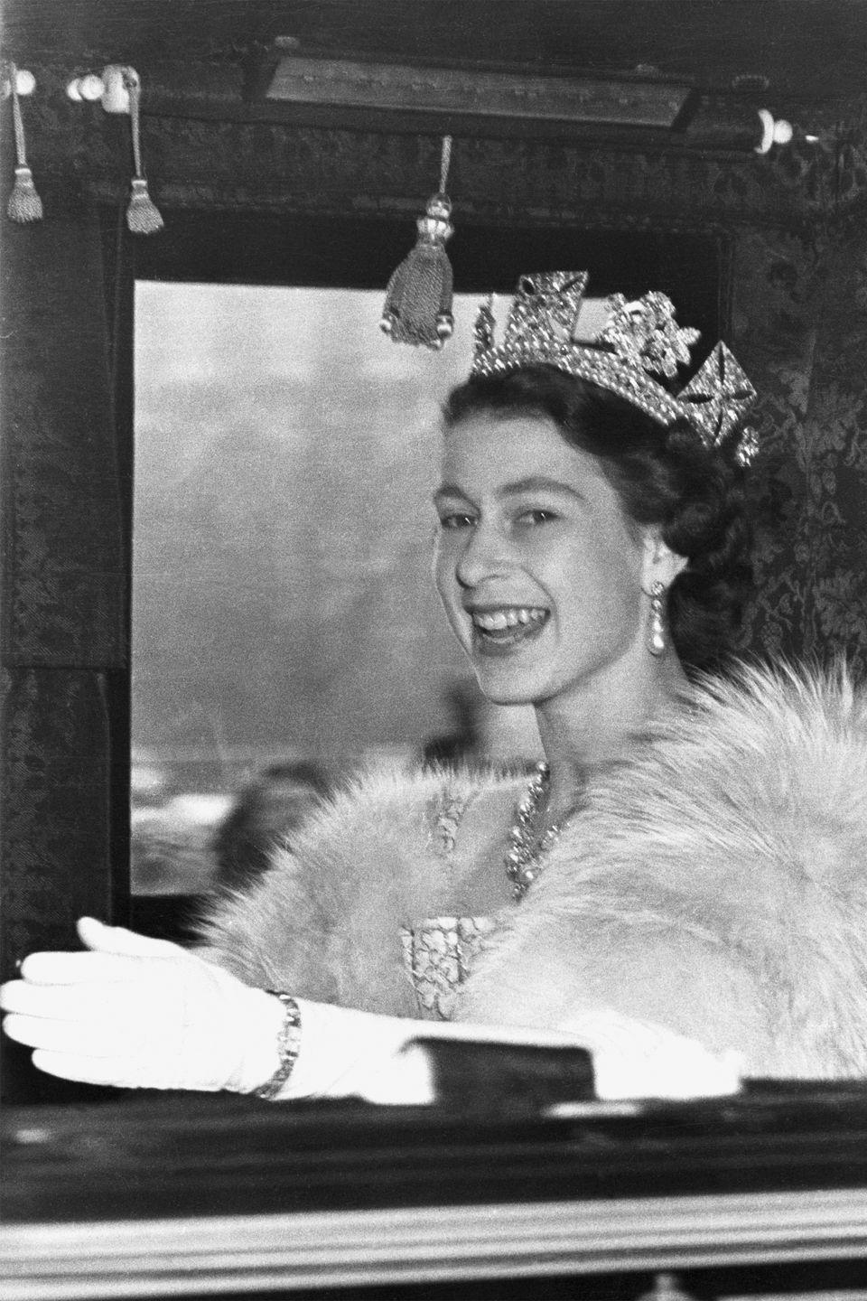<p>During her first year as Queen of England, Elizabeth was snapped as she arrived at Westminster to open Parliament.</p>