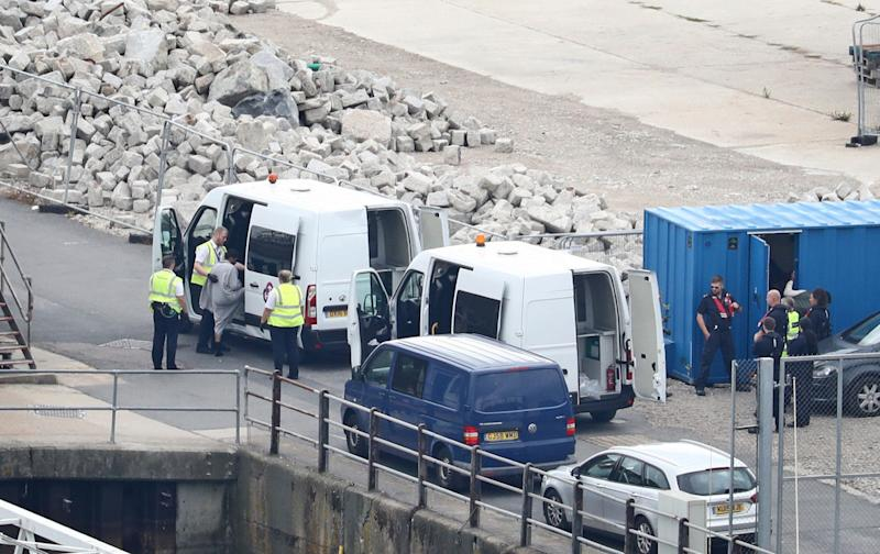 A group of people thought to be migrants are brought to shore by Border Force officers at the Port of Dover on Monday (Picture: PA)