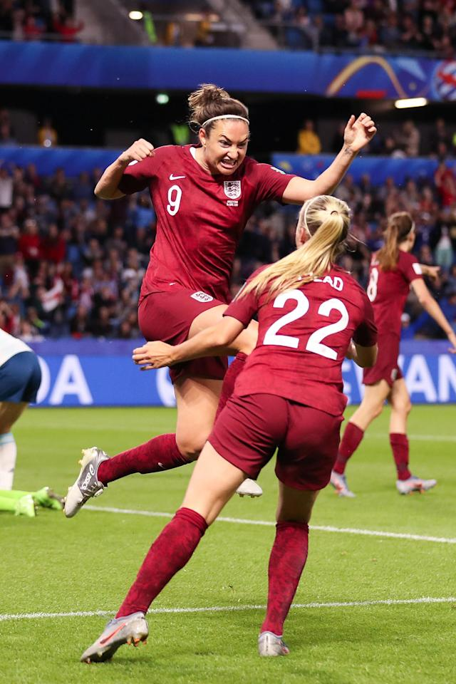 Jodie Taylor of England celebrates with Beth Mead of England after scoring a goal to make it 1-0 during the 2019 FIFA Women's World Cup France group D match between England and Argentina at Stade Oceane on June 14, 2019 in Le Havre, France. (Photo by Molly Darlington - AMA/Getty Images)