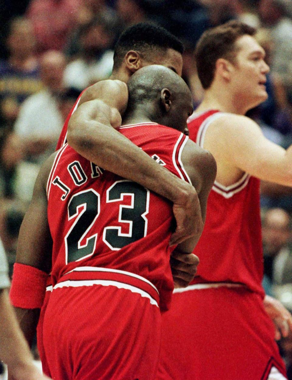 Chicago Bulls guard Michael Jordan is helped off the court by team mate Scottie Pippen after the Chicago Bulls defeated the Utah Jazz 90-88 in game 5 of the NBA finals in Salt Lake City, June 11. Jordan suffered from flu-like symptoms during the game. In background is Luc Longley.  SPORT NBA