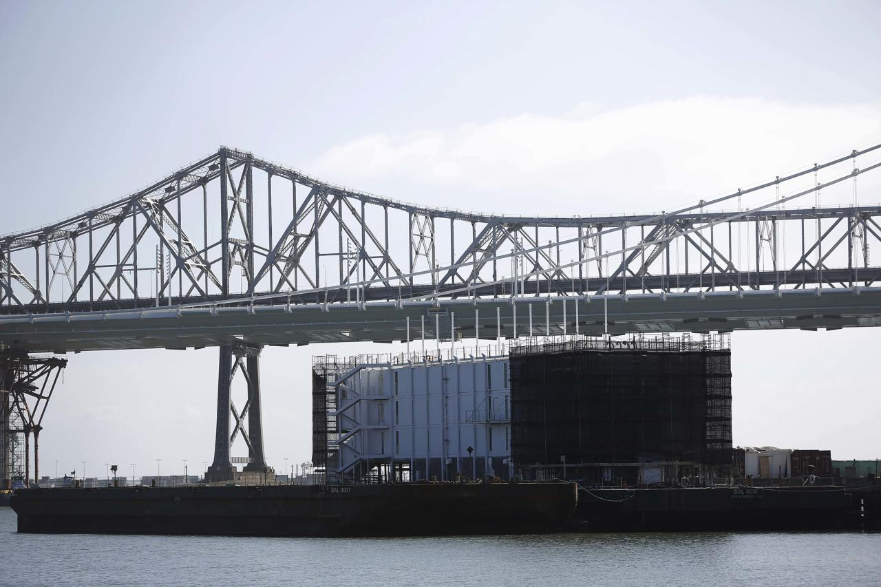 A barge built with four levels of shipping containers is seen at Pier 1 at Treasure Island in San Francisco, California October 28, 2013. How badly does Google want to keep under wraps a mysterious project taking shape on a barge in San Francisco Bay? Badly enough to require U.S. government officials to sign confidentiality agreements. REUTERS/Stephen Lam (UNITED STATES - Tags: SCIENCE TECHNOLOGY BUSINESS)