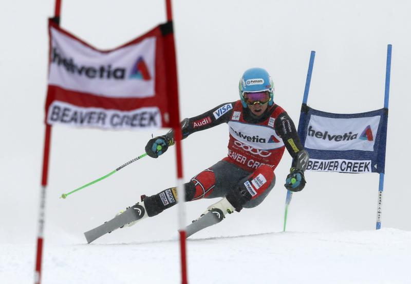 Ted Ligety lines up another gate during the men's World Cup giant slalom skiing event, Sunday, Dec. 8, 2013, in Beaver Creek, Colo. (AP Photo/ Charles Krupa)
