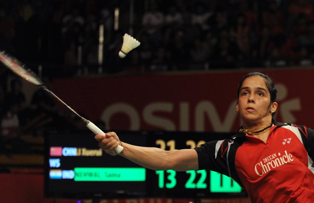 Saina Nehwal of India returns the shuttlecock against Li Xuerui of China during the women's badminton finals at the Indonesian Open Superseries in Jakarta on June 16, 2012. Nehwal defeated Li 13-21, 22-20, 21-19. AFP PHOTO / ROMEO GACAD        (Photo credit should read ROMEO GACAD/AFP/GettyImages)