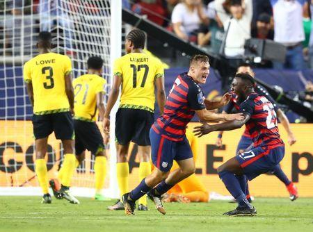 Jul 26, 2017; Santa Clara, CA, USA; United States forward Jordan Morris (center) celebrates with forward Jozy Altidore after scoring a goal in the second half against Jamaica during the CONCACAF Gold Cup final at Levi's Stadium. Mandatory Credit: Mark J. Rebilas-USA TODAY Sports