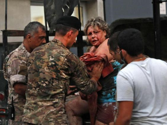 Wounded people received help outside a hospital (AFP via Getty Images)