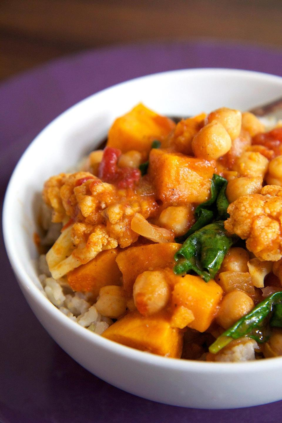"""<p>You can prep this vegan and gluten-free curry recipe in your slow cooker before work and have a restaurant-worthy meal for dinner. Serve it over cauliflower rice.</p> <p><strong>Get the recipe:</strong> <a href=""""https://www.popsugar.com/fitness/Slow-Cooker-Vegan-Chickpea-Curry-34162942"""" class=""""link rapid-noclick-resp"""" rel=""""nofollow noopener"""" target=""""_blank"""" data-ylk=""""slk:chickpea and sweet potato curry recipe"""">chickpea and sweet potato curry recipe</a></p>"""