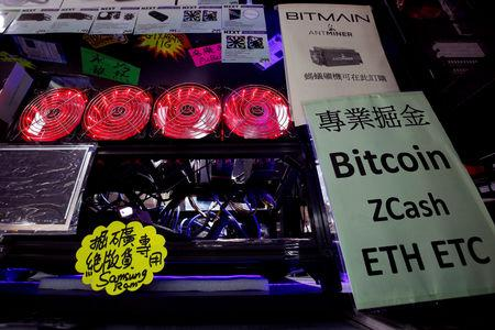 FILE PHOTO - A cryptocurrency mining computer is displayed at a computer mall in Hong Kong