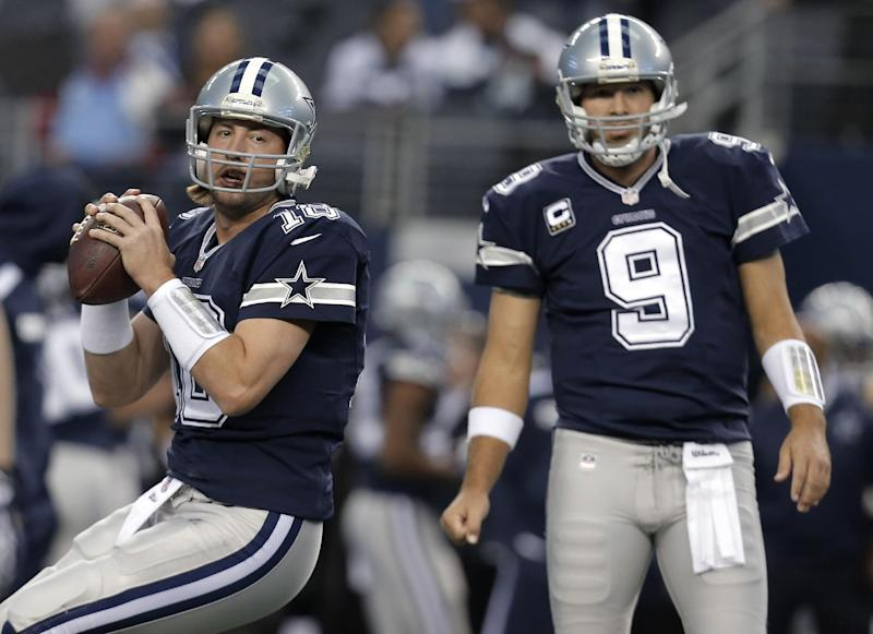 In this Nov. 28, 2013, photo, Dallas Cowboys quarterbacks Kyle Orton (18) and Tony Romo (9) warm up for an NFL football game against the Oakland Raiders in Arlington, Texas. Orton will make his first start at quarterback in his two seasons with the Cowboys on Sunday night, Dec. 29, unless Romo can recover from a herniated disc. Dallas will be playing a winner-take-all game at home against the Philadelphia Eagles for the NFC East title and a playoff berth. (AP Photo/Brandon Wade)