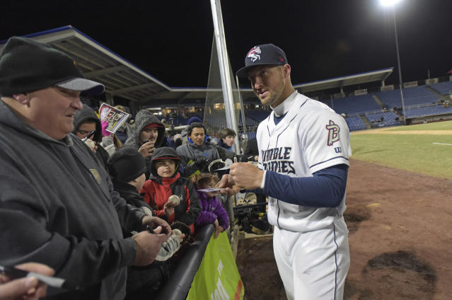 He might not be performing like a star, but fans still treat Tim Tebow like a star. (AP Photo)