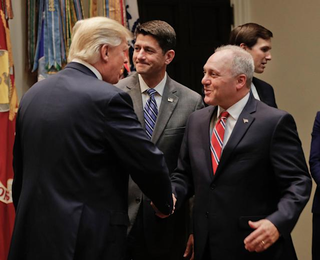 <p>President Donald Trump, left, greets House Majority Whip Steve Scalise of La., before the start of a meeting with House and Senate Leadership in the Roosevelt Room of the White House in Washington, Tuesday, June 6, 2017. Also in the room are House Speaker Paul Ryan of Wis., center, and Senior adviser to President Donald Trump Jared Kushner, far right. (Photo: Pablo Martinez Monsivais/AP) </p>
