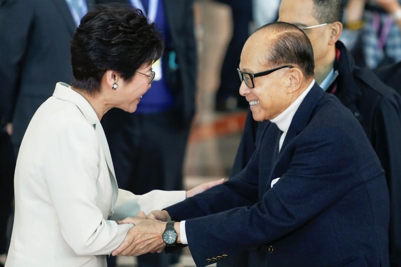 FILE PHOTO: Tycoon Li Ka-shing shakes hands with Carrie Lam before voting during the election for Hong Kong's next Chief Executive in Hong Kong