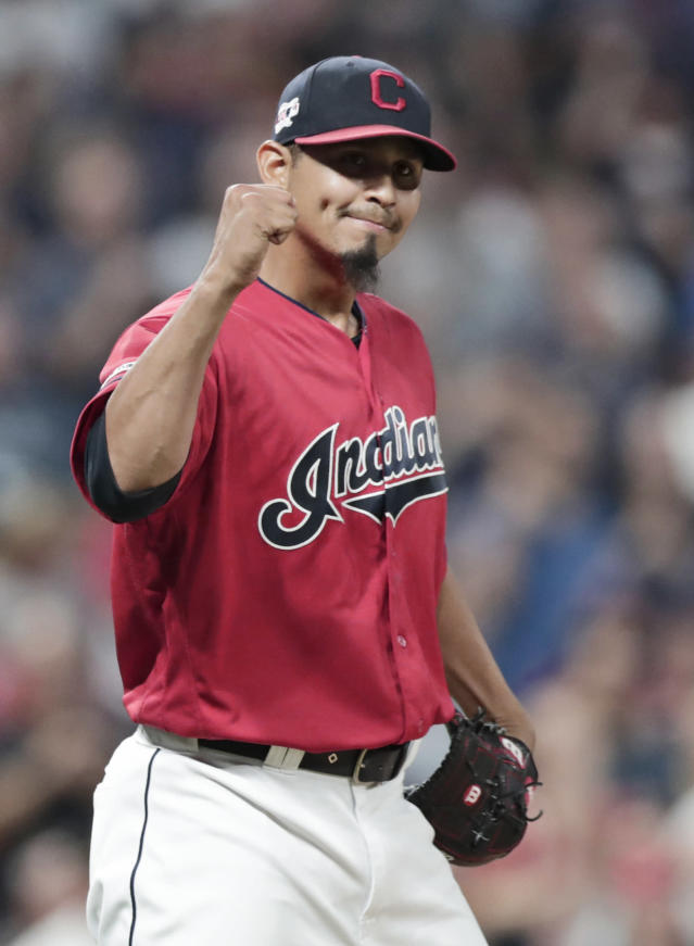 Cleveland Indians relief pitcher Carlos Carrasco pumps his fist after the Indians defeated the Philadelphia Phillies 5-2 in a baseball game, Friday, Sept. 20, 2019, in Cleveland. (AP Photo/Tony Dejak)