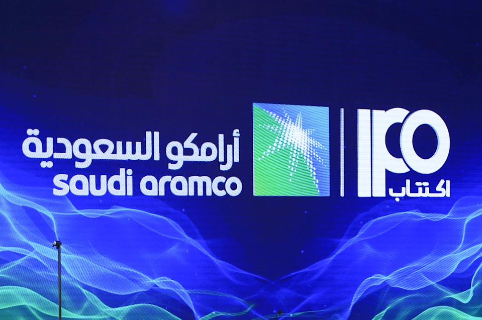 """A picture taken on November 3, 2019 shows a sign of Saudi Aramco's initial public offering (IPO) during a press conference by the state company in the eastern Saudi Arabian region of Dhahran. - Saudi Aramco confirmed it planned to list on the Riyadh stock exchange, describing it as a """"significant milestone"""" in the history of the energy giant. (Photo by - / AFP) (Photo by -/AFP via Getty Images)"""