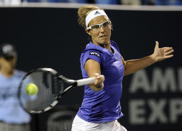 Kirsten Flipkens, of Belgium, hits a forehand during a quarterfinal match against Samantha Stosur at the New Haven Open tennis tournament in New Haven, Conn., on Thursday, Aug. 21, 2014. (AP Photo/Fred Beckham)