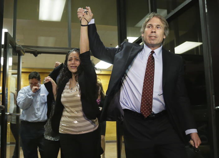 Cassandra Rivera, center, followed by Elizabeth Ramirez and Kristie Mayhugh are led out of the Bexar County Jail by their attorney Mike Ware, right, Monday, Nov. 18, 2013, in San Antonio. It was announced earlier in the day the San Antonio women imprisoned for sexually assaulting two girls in 1994 were expected to walk free Monday after a judge agreed that their convictions were tainted by faulty witness testimony. Vasquez, the fourth, has already been paroled, but under strict conditions. (AP Photo/Eric Gay)